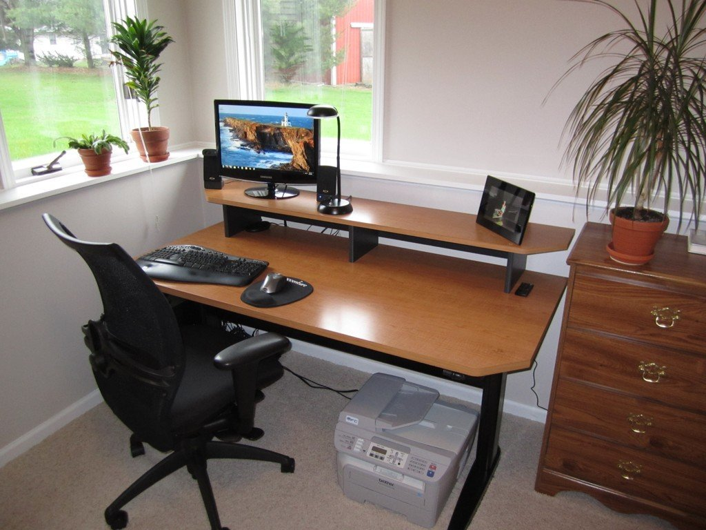 Adjustable height desk sitting