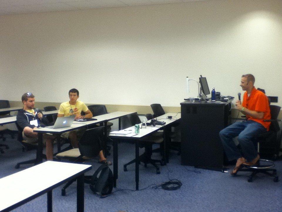 Chad Warner and Brian Richards talking to Dustin Hartzler
